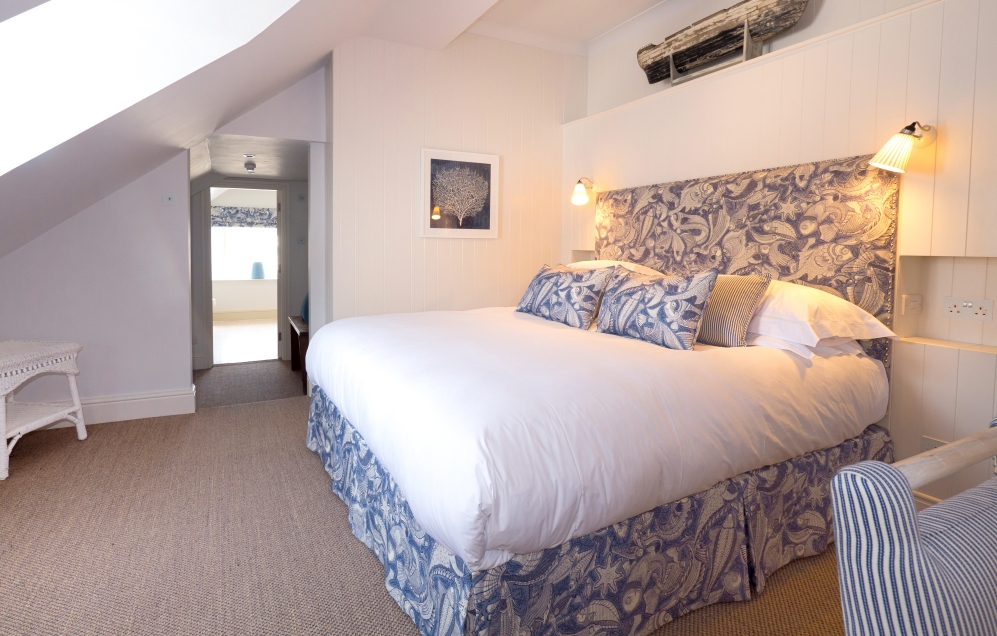 view of the bed in village hideaway room at The Idle Rocks Hotel, St Mawes