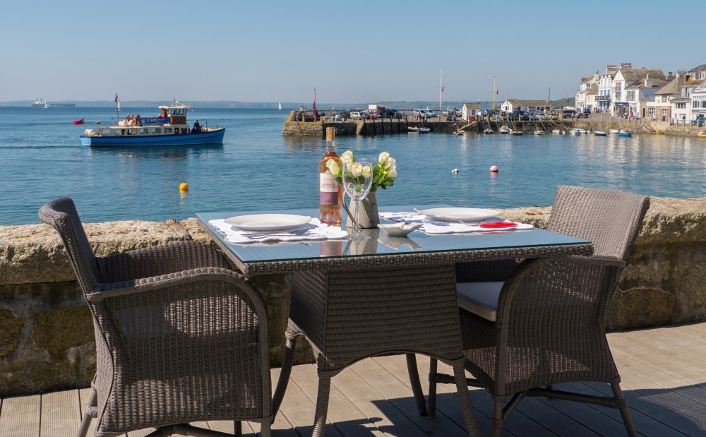 view of the terrace and harbour at Idle Rocks Hotel, St Mawes,