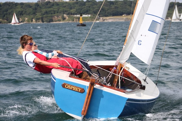 2 people in a small sailing dinghy