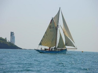 sailing yacht with lighhouse