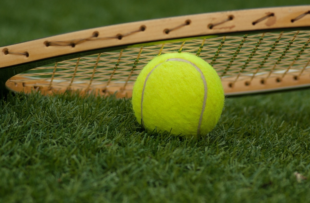 Play Tennis in St Mawes - Tennis ball and tennis racket