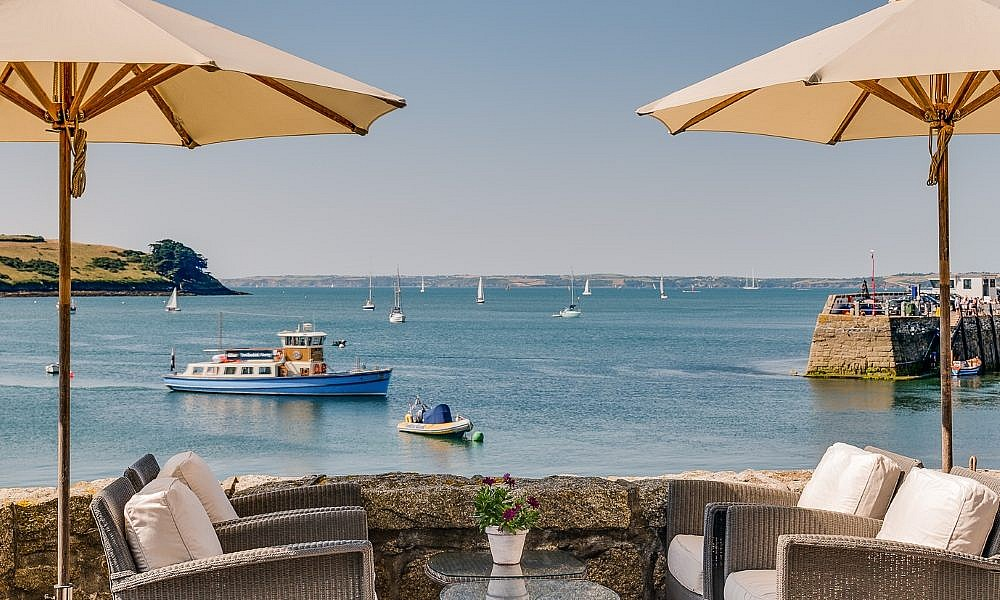 view of a blue boat from the terrace at The Idle Rocks Hotel, St Mawes,