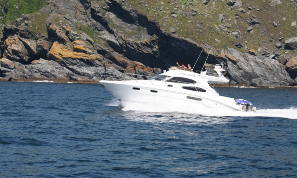 a motor boat cruising the cornish coast