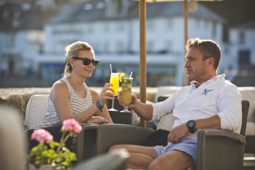 a couple enjoying a cocktail on the sea terrace