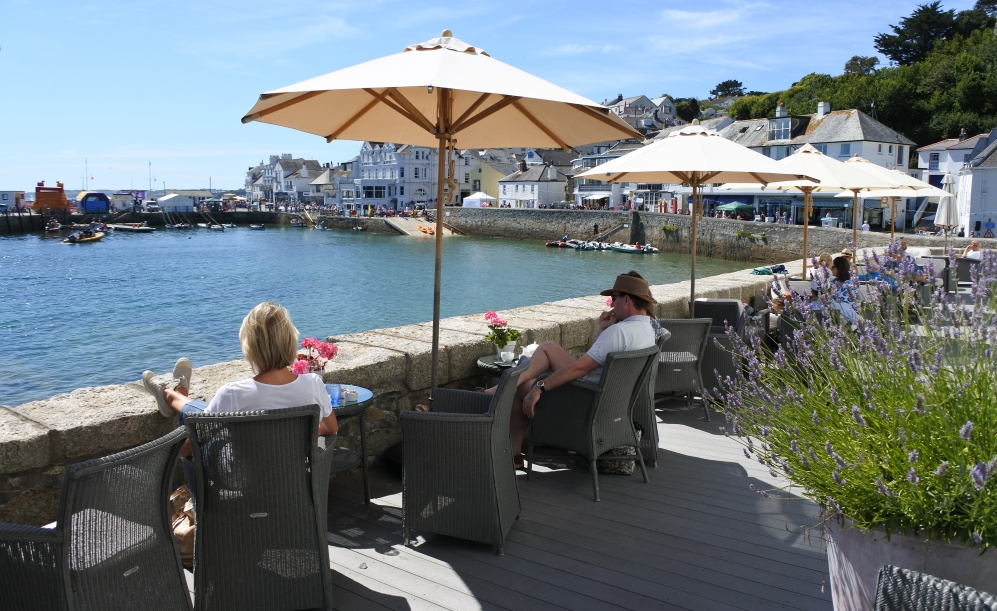 guests enjoying the seaview and sunshine on the terrace at the Idle Rocks